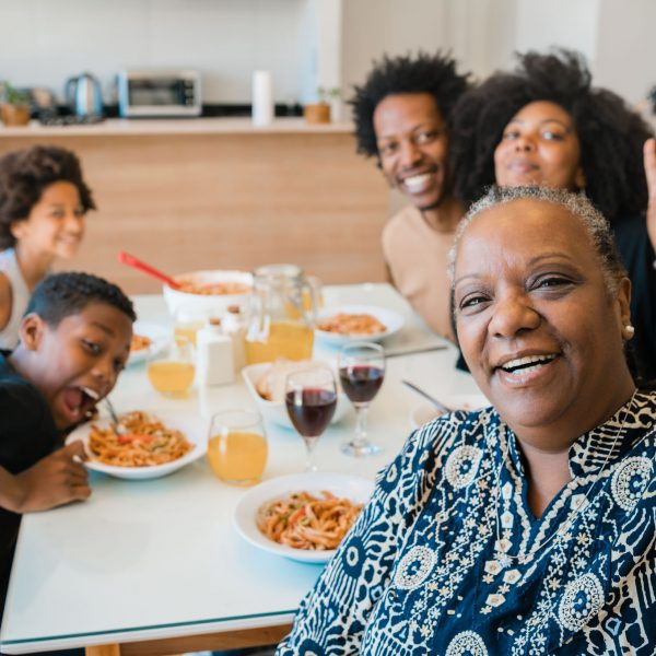 portrait-african-american-multigenerational-family-taking-selfie-together-while-having-dinner-home